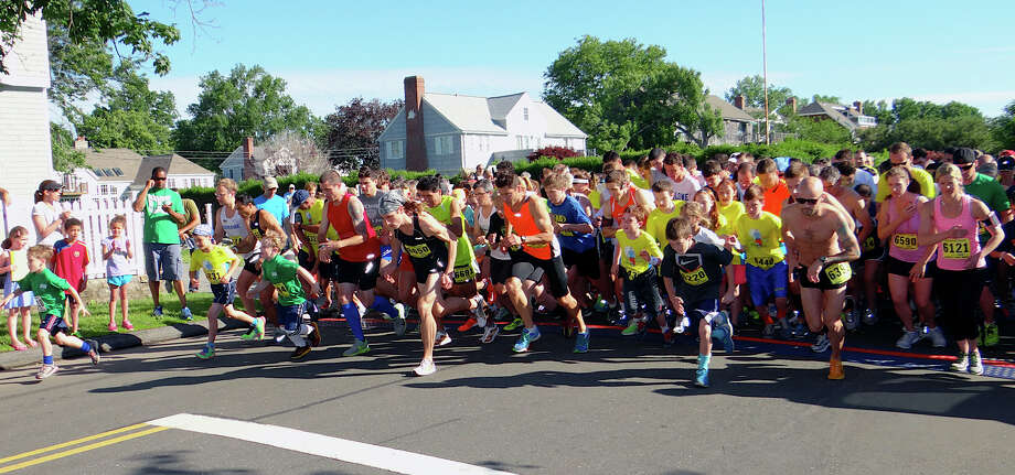Runners step off the starting line on Fairfield Beach Road for the Stratton Faxon 5K Road Race on Saturday morning. Photo: Mike Lauterborn / Fairfield Citizen