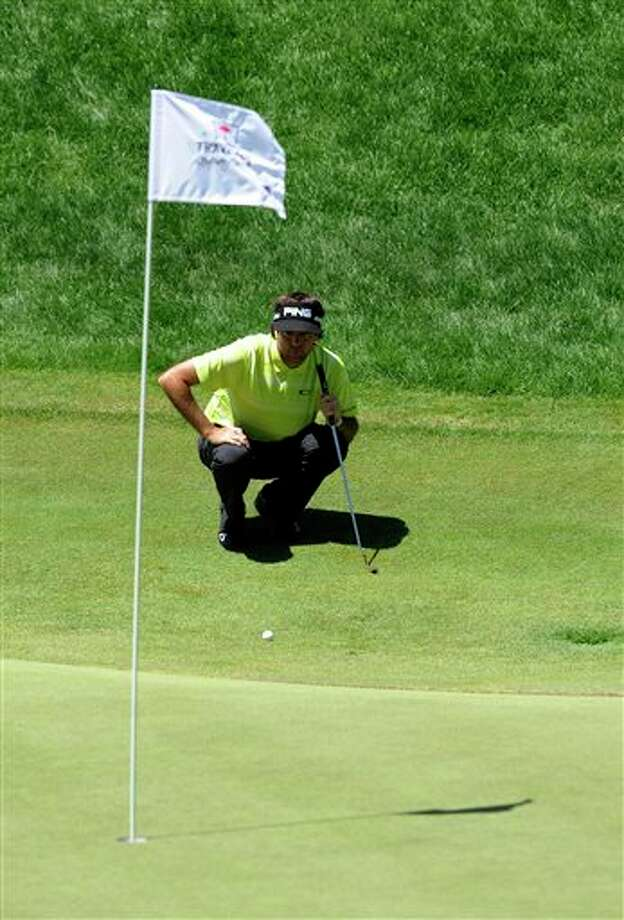 Bubba Watson reads his putt  on the 18th hole during the third round of the Travelers Championship  golf tournament in Cromwell, Conn., Saturday, June 21, 2014. (AP  Photo/Fred Beckham)