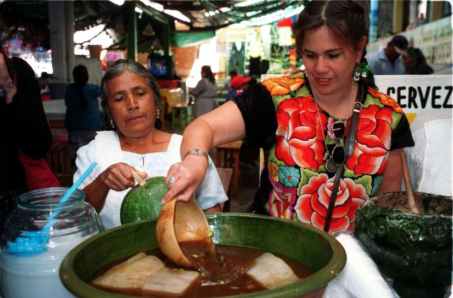 Cookbook author Susana Trilling, right, pours herself a chocolate-based drink from a refreshment stand in the Etla market, Oaxaca, Mexico. (Photo: Dai  Huynh) Photo: Dai Huynh, Houston Chronicle