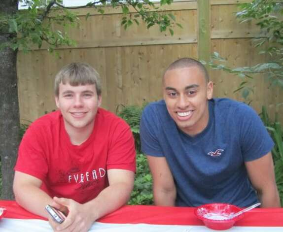 Noah Fowler was five and Austin Ebanks was eight in 2003 when Austin first stayed with the family. Here they are 11 years later at the Fowler home in Loudonville before Austin, now 19, heads off to Marine boot camp in South Carolina. (Christine Fowler) Photo: Picasa