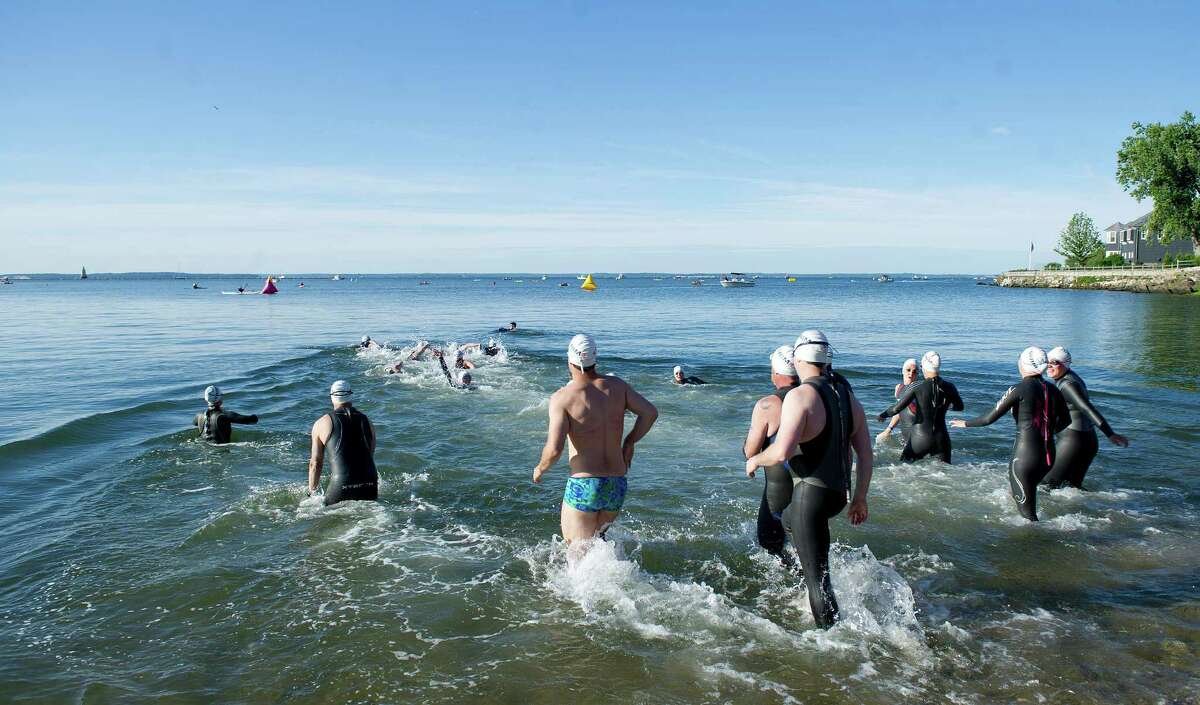 Swimmers begin the three-mile distance swim during the eighth-annual Greenwich-Stamford Swim Across America event on Saturday, June 21, 2014.