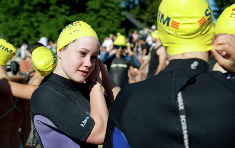 Georgia Leigh puts on her cap during the eighth-annual Greenwich-Stamford Swim Across America event on Saturday, June 21, 2014. Photo: Lindsay Perry / Stamford Advocate