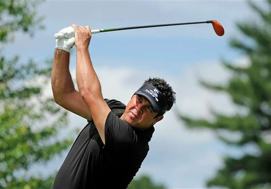 Eric Axley watches his drive on the second hole during the third round of the Travelers Championship golf tournament in Cromwell, Conn., Saturday, June 21, 2014. (AP Photo/Fred Beckham)