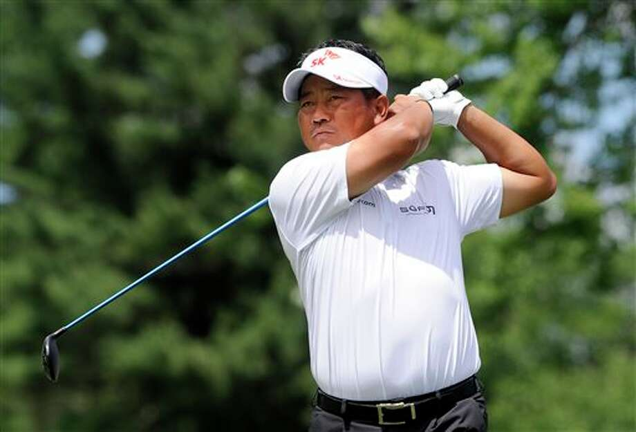 K.J. Choi watches his drive on the second hole during the third round of the Travelers Championship golf tournament in Cromwell, Conn., Saturday, June 21, 2014. (AP Photo/Fred Beckham)