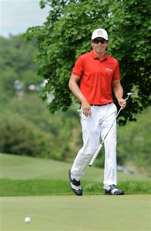 Scott Langley reacts after missing his birdie putt on the second hole during the third round of the TravelersChampionship golf tournament in Cromwell, Conn., Saturday, June 21, 2014. (AP Photo/Fred Beckham
