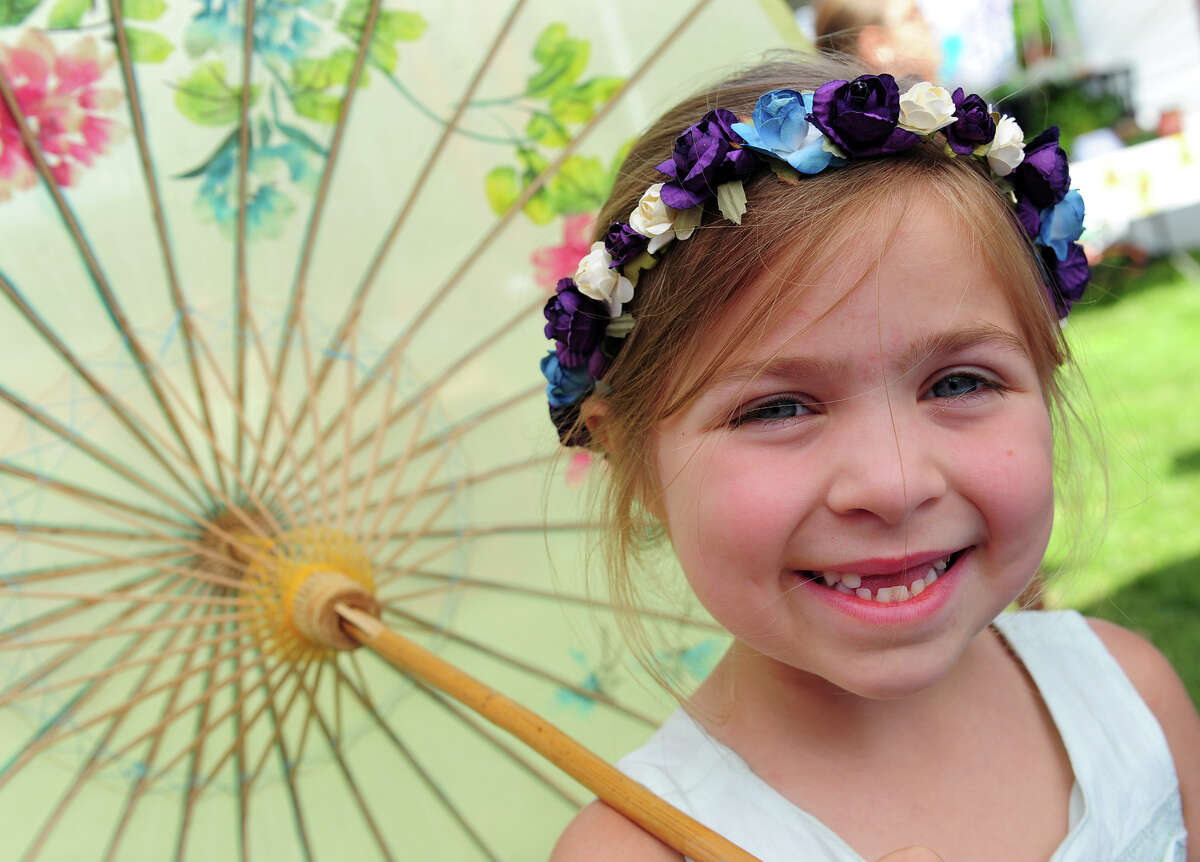 Bethany Harris, 6, of Oxford, attends the 5th Annual Soupstock Music and Arts Festival in Shelton, Conn. on Saturday June 21, 2014. The festival continues on Sunday from 11-6.