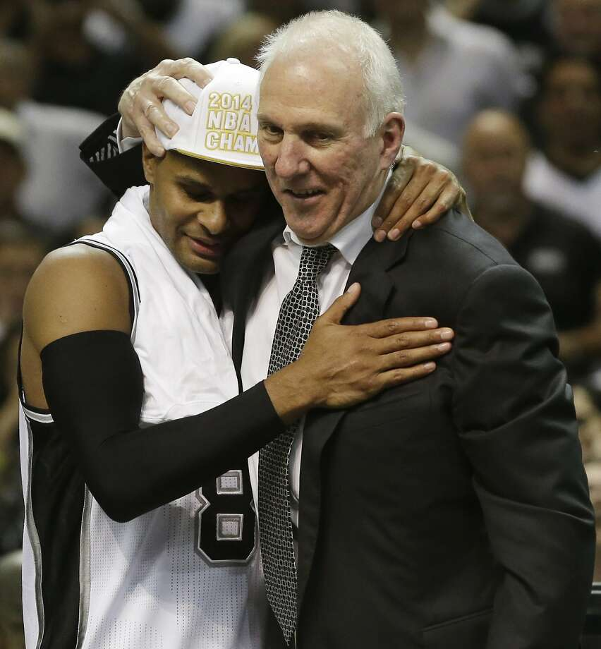 Patty Mills, shown with Spurs coach Gregg Popovich, will himself be a coach Sunday. Photo: David J. Phillip, Associated Press