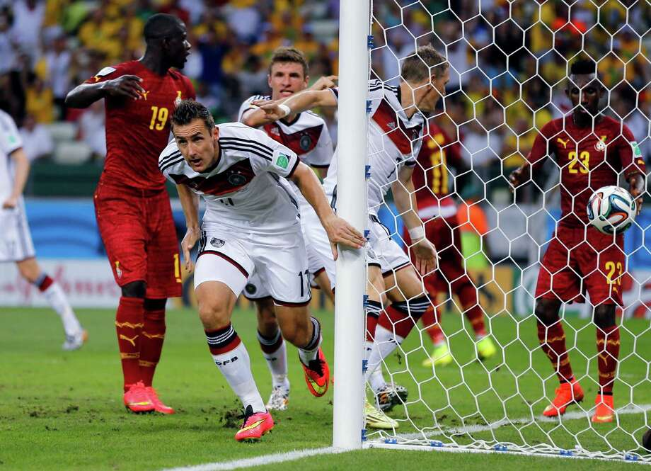 Germany's Miroslav Klose, center, celebrates after scoring his sides second goal during the group G World Cup soccer match between Germany and Ghana at the Arena Castelao in Fortaleza, Brazil, Saturday, June 21, 2014. (AP Photo/Frank Augstein) Photo: Frank Augstein, Associated Press / AP
