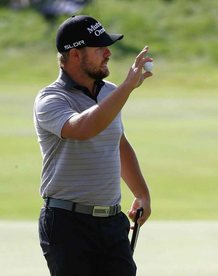 CROMWELL, CT - JUNE 21: Ryan Moore of the United States waves to the crowd after making his putt on the 17th hole during the third round of the Travelers Championship golf tournament at the TPC River Highlands on June 21, 2014 in Cromwell, Connecticut. Photo: Jim Rogash, Getty Images / 2014 Getty Images