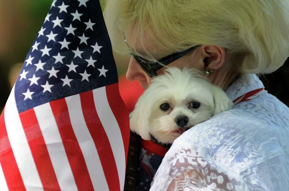 oFran Ondras of Colonie and her Maltese, Vinny, are dressed as Two Americans during the Paws in the Park Walk and Community Day on Saturday, June 21, 2014, at Siena College in Loudonville, N.Y. The fundraiser benefits the Mohawk Hudson Humane Society. (Cindy Schultz / Times Union) Photo: Cindy Schultz / 00027115A