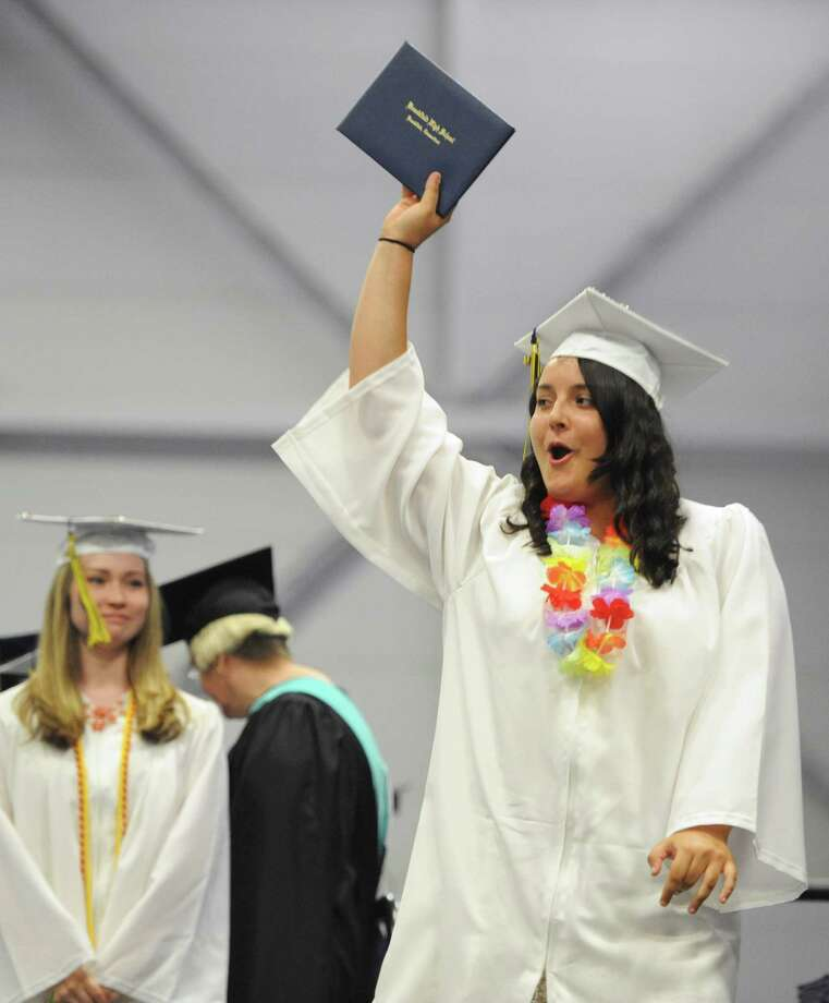 Brianna D'Arcangelo celebrates after receiving her diploma at the Brookfield High School 2014 Graduation Ceremony at Western Connecticut State University's O'Neill Center in Danbury, Conn. Saturday, June 21, 2014. Photo: Tyler Sizemore / The News-Times