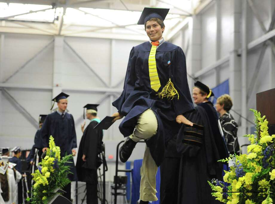 Andrew Manning skips across stage during the Brookfield High School 2014 Graduation Ceremony at Western Connecticut State University's O'Neill Center in Danbury, Conn. Saturday, June 21, 2014. Photo: Tyler Sizemore / The News-Times