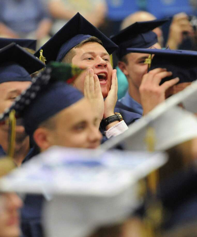 Eric Speglevin cheers during the Brookfield High School 2014 Graduation Ceremony at Western Connecticut State University's O'Neill Center in Danbury, Conn. Saturday, June 21, 2014. Photo: Tyler Sizemore / The News-Times