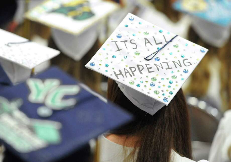 "A student wears a cap with the words ""It's all happening"" during the Brookfield High School 2014 Graduation Ceremony at Western Connecticut State University's O'Neill Center in Danbury, Conn. Saturday, June 21, 2014. Photo: Tyler Sizemore / The News-Times"