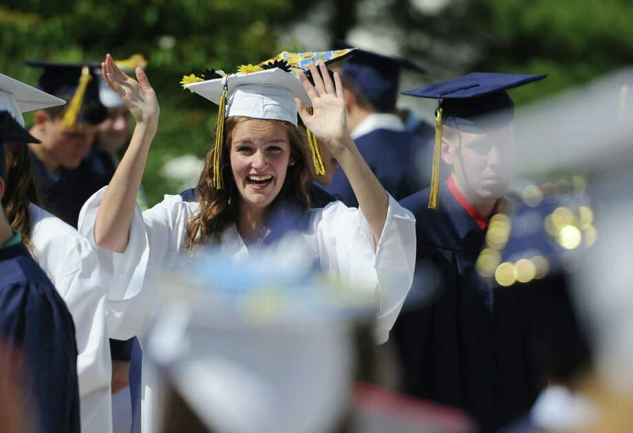 Michelle Fleming waves to fellow graduates before the Brookfield High School 2014 Graduation Ceremony at Western Connecticut State University's O'Neill Center in Danbury, Conn. Saturday, June 21, 2014. Photo: Tyler Sizemore / The News-Times