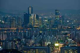 TO GO WITH SKorea-economy-property,FEATURE by Jung Ha-Won  (FILES) This file photo taken on May 9, 2014 shows a general view of the Seoul city skyline at dusk. A lengthy property market slump and low interest rates are threatening the future of a uniquely South Korean home lease system that traces its roots back to the 19th century.   AFP PHOTO / FILES / Ed JonesED JONES/AFP/Getty Images
