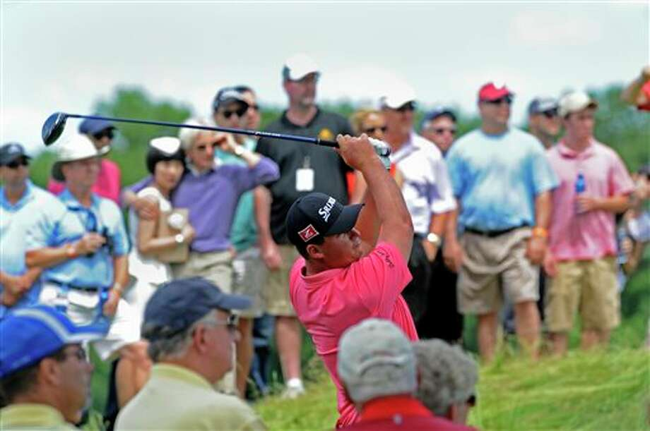 Michael Putnam watches his drive on the third hole during the third round of the TravelersChampionship golf tournament in Cromwell, Conn., Saturday, June 21, 2014. (AP Photo/Fred Beckham)