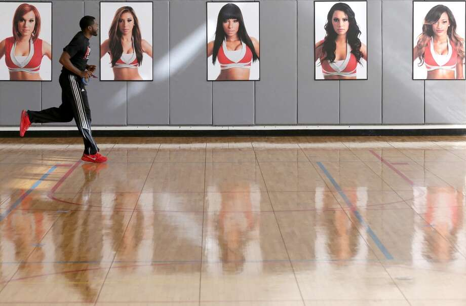 RPD staff member Mychal Mitchell runs in the gymnasium before the audition. Photo: Thomas B. Shea, For The Chronicle