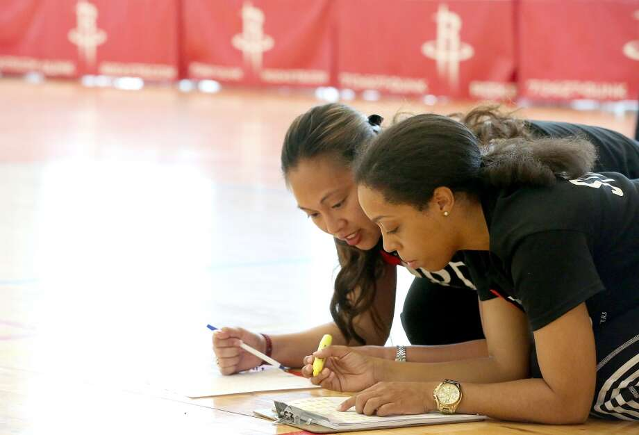 RPD dance staff members Leilann Costa and Aryone Crocket add up scores from the first round. Photo: Thomas B. Shea, For The Chronicle