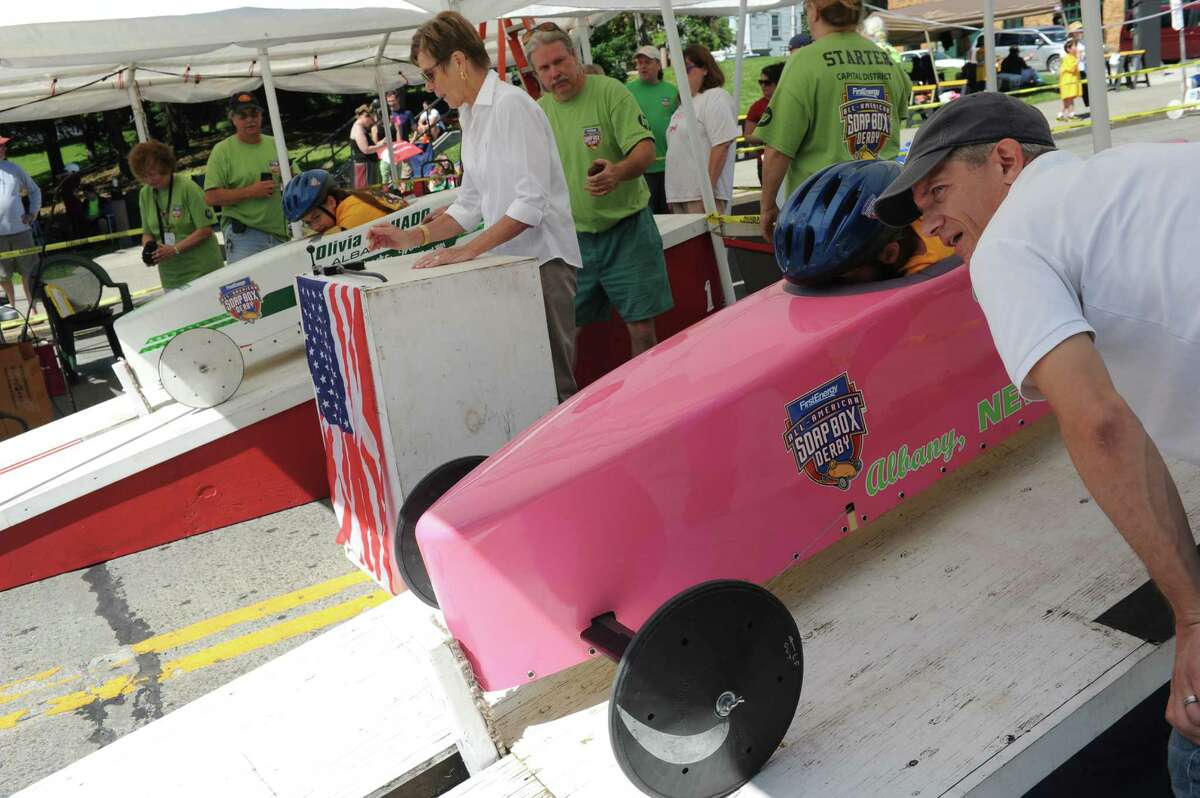 Steve Burdgick, right, checks in with his stepdaughter Ava Gamello, 9, of Guilderland before her run during Soap Box Derby racing on Saturday June 21, 2014 in Albany, N.Y. Ava took first place in the Stock division. (Michael P. Farrell/Times Union)