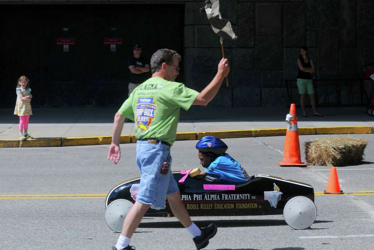 Amina Webster crosses the finish line during Soap Box Derby racing on Saturday June 21, 2014 in Albany, N.Y. (Michael P. Farrell/Times Union)