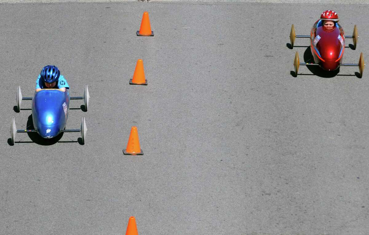 Ryan Penman, left, and Taylor VanDenburg face off during Soap Box Derby racing on Saturday June 21, 2014 in Albany, N.Y. (Michael P. Farrell/Times Union)