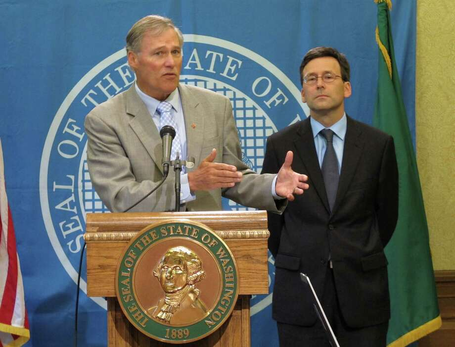 Gov. Jay Inslee and Attorney General Bob Ferguson:  The man on the right received nearly 200,000 more votes than the man on the left in Tuesday's election, and carried 25 counties that the Governor lost.  Photo: Rachel La Corte, AP / AP
