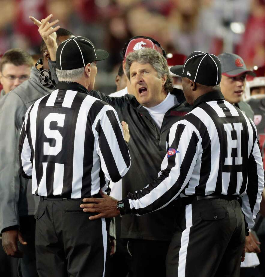 Mike Leach, Washington State University head football coachSalary: More than $2.3 million (2013).Leach, center, was the second highest paid state worker in 2013.  Photo: William Mancebo, Getty Images / 2013 Getty Images