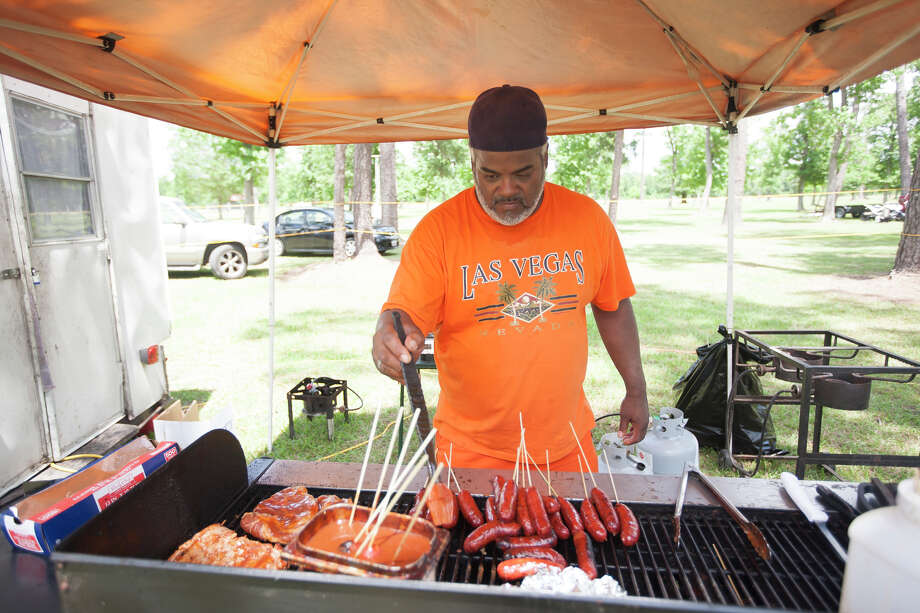 Dale Pollard of Lil Pappy's on Wheels cooks a variety of food. Photo: Miguel Perez