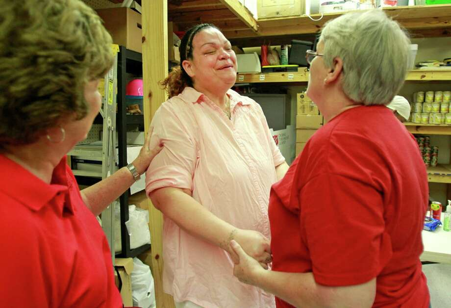 Carolyn King, left, and Kathie Gallagher, right, say goodbye to Darlene Marmolejo, center, after assisting her and other women who were released from prison. Photo: Melissa Phillip, Staff / © 2014  Houston Chronicle