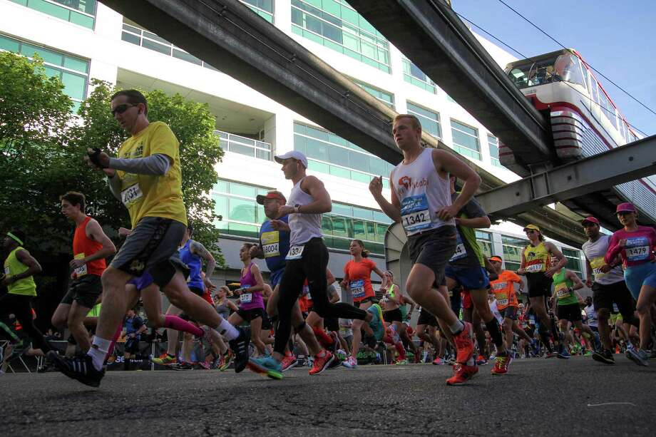 Runners take off from the start line during the annual Seattle Rock 'n' Roll Marathon & Half Marathon on Saturday, June 21, 2014. This year the event drew about 18,000 entrants. Photo: JOSHUA BESSEX, SEATTLEPI.COM / SEATTLEPI.COM