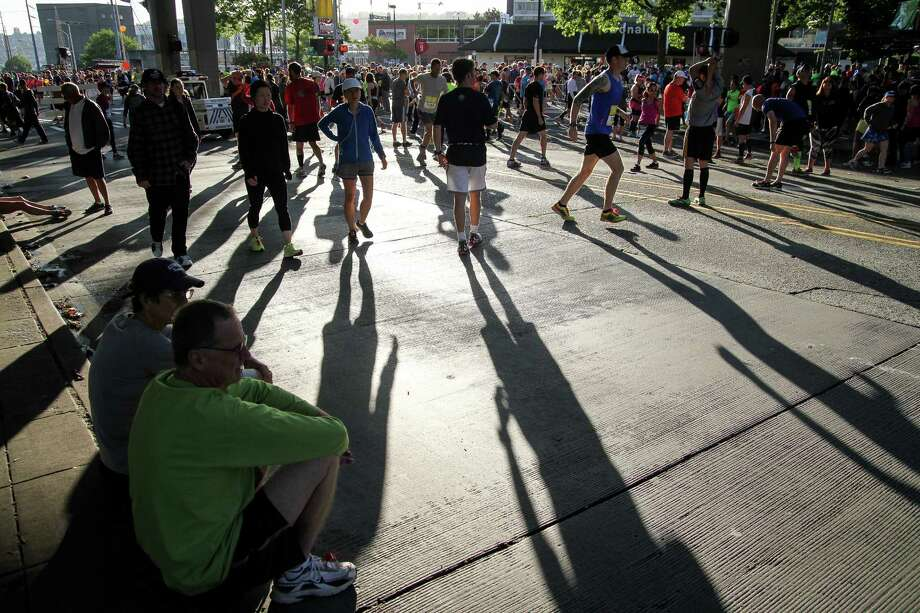 Some runners sit while others warm up prior to the event. Photo: JOSHUA BESSEX, SEATTLEPI.COM / SEATTLEPI.COM