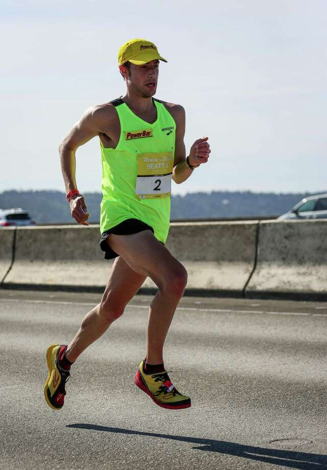 Drew Polley runs along the Interstate 90 floating bridge. Polley placed first for the men's full marathon with a time of 2:24:52. Photo: JOSHUA BESSEX, SEATTLEPI.COM / SEATTLEPI.COM