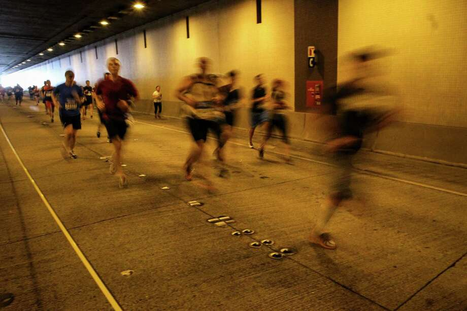 Runners make their way through the Interstate 90 tunnel. Photo: JOSHUA BESSEX, SEATTLEPI.COM / SEATTLEPI.COM