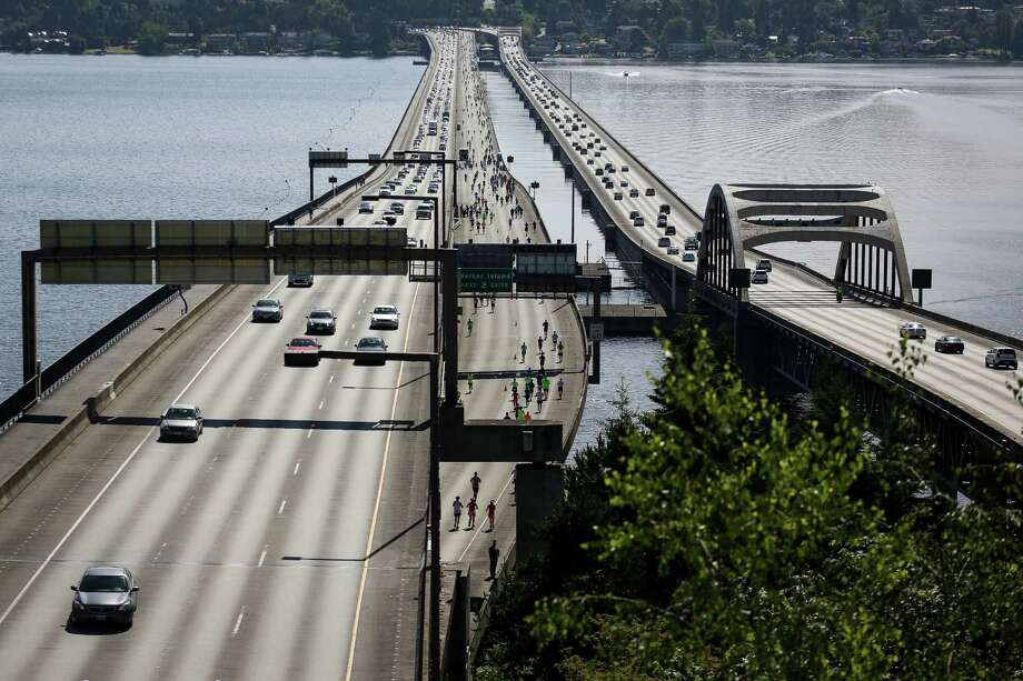 Runners make their way across the Interstate 90 floating bridge during the annual Rock 'n' Roll Seattle Marathon on Saturday, June 21, 2014. This year the marathon and 1/2 marathon drew about 18,000 entrants. Photo: JOSHUA BESSEX, SEATTLEPI.COM / SEATTLEPI.COM