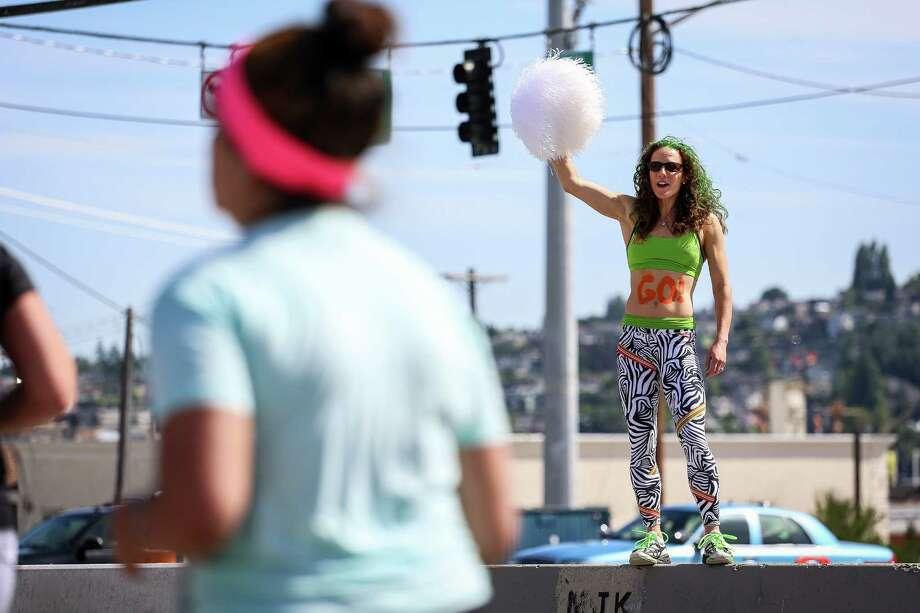 A woman cheers on runners. Photo: JOSHUA BESSEX, SEATTLEPI.COM / SEATTLEPI.COM