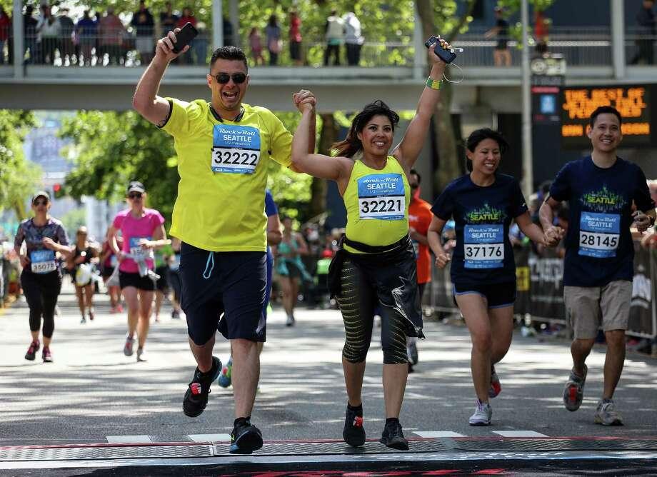 Rick Martin (left) and Kim Hee cross the finish line. Photo: JOSHUA BESSEX, SEATTLEPI.COM / SEATTLEPI.COM