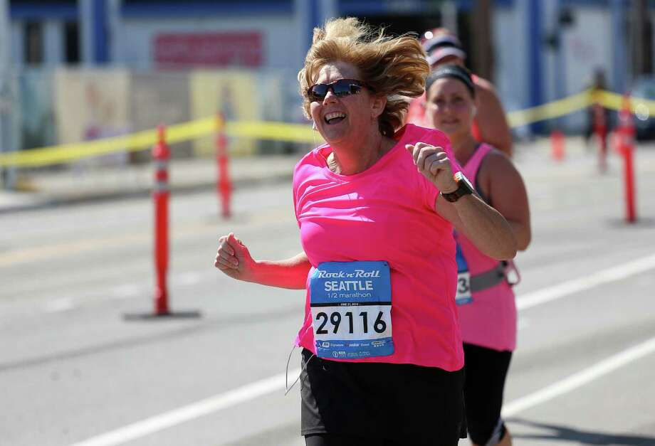 A runner rocks out as she passes Navy Band Northwest. Photo: JOSHUA BESSEX, SEATTLEPI.COM / SEATTLEPI.COM