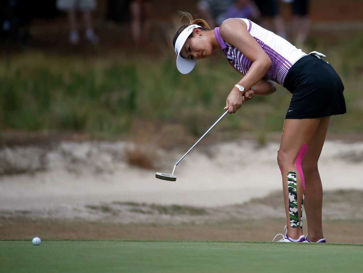 Michelle Wie putts on the seventh hole during the third round of the U.S. Women's Open golf tournament in Pinehurst, N.C., Saturday, June 21, 2014. (AP Photo/John Bazemore) ORG XMIT: NCCB134