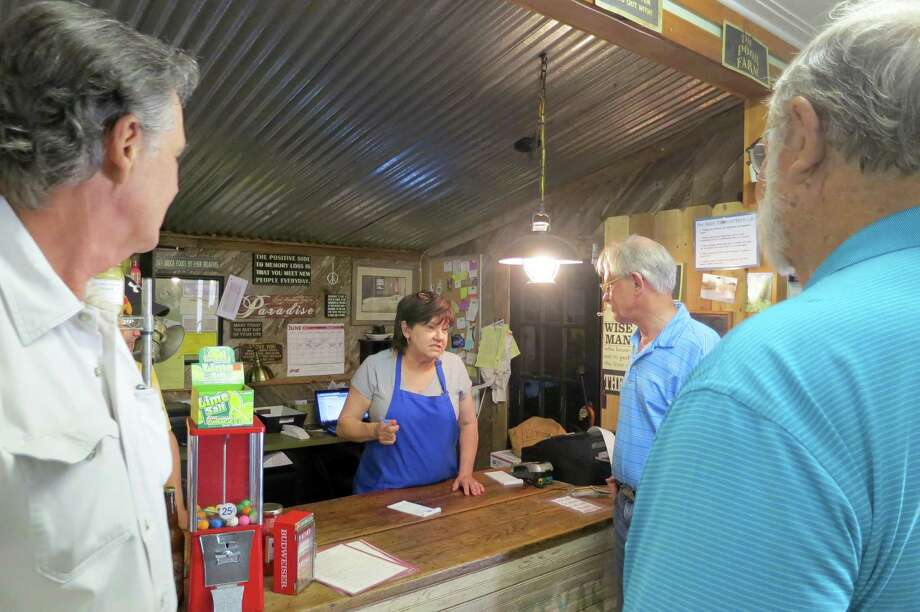 "Diana McLennan cooks up some of the best burgers at the historic Morales Store, a little grocery and short-order grill. ""There's never anything frozen,"" she said. ""We make our patties fresh every day."" Photo: Joe Holley / Houston Chronicle"