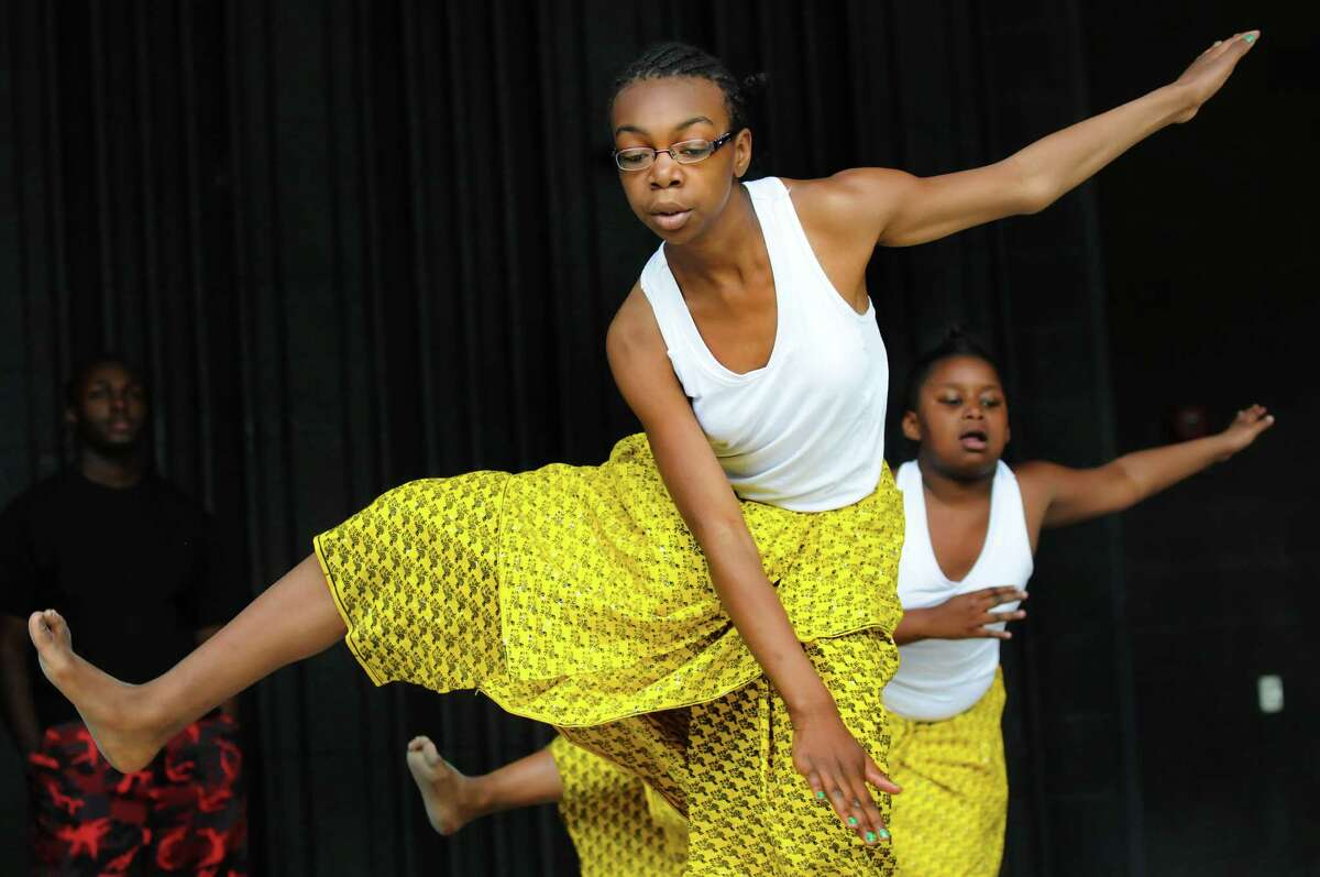 Jynnae Stevens, 11, left, and Jahnasia Gardner, 9, perform with the dance troop Umoja during the 14th Annual Celebration of Juneteenth on Saturday, June 21, 2014, at Central Park in Schenectady, N.Y. Juneteenth is the oldest known celebration commemorating the end of slavery in the United States. (Cindy Schultz / Times Union)