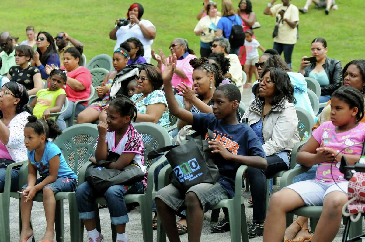 The audience shows their appreciation during the 14th Annual Celebration of Juneteenth on Saturday, June 21, 2014, at Central Park in Schenectady, N.Y. Juneteenth is the oldest known celebration commemorating the end of slavery in the United States. (Cindy Schultz / Times Union)
