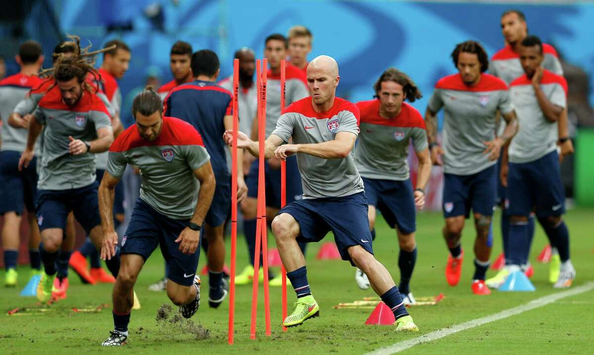 United States' Michael Bradley, center left, runs through obstacles with teammates during a training session at the Arena da Amazonia in Manaus, Brazil, Sunday, June 22, 2014. The U.S. will play Portugal in group G of the 2014 soccer World Cup on June 22. (AP Photo/Paulo Duarte) ORG XMIT: BRAJC133