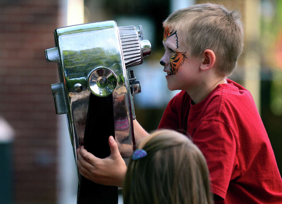 Colin Alexander, 8, of Monroe, and his sister Kailey, 10, take turns looking at the Siberian Tiger through the binoculars, during the 7th Annual Survivor Safari held for cancer survivors and their families at Beardsley Zoo in Bridgeport, Conn. on Saturday June 21, 2014. The event, which is in its seventh year, was hosted by Bridgeport Hospital's Norma F. Pfriem Cancer Institute. Photo: Christian Abraham / Connecticut Post