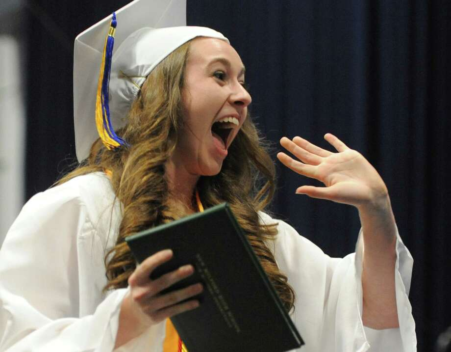 Jaclyn Mercer waves excitedly after receiving her diploma at the New Milford High School 2014 Graduation Ceremony at Western Connecticut State University's O'Neill Center in Danbury, Conn. Saturday, June 21, 2014. Photo: Tyler Sizemore / The News-Times