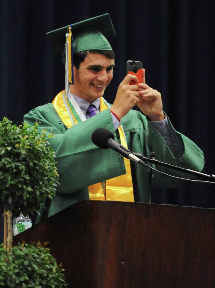 Salutatorian Nevan Swanson takes a panorama on stage before delivering a speech at the New Milford High School 2014 Graduation Ceremony at Western Connecticut State University's O'Neill Center in Danbury, Conn. Saturday, June 21, 2014. Photo: Tyler Sizemore / The News-Times