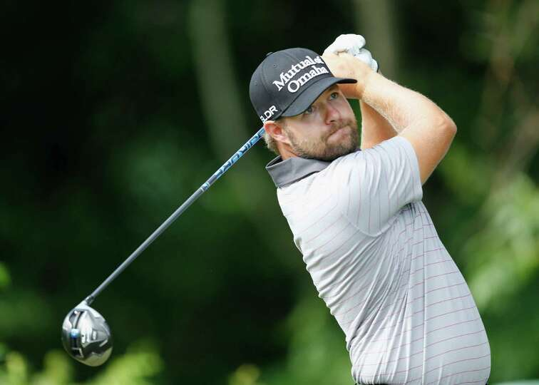 CROMWELL, CT - JUNE 21: Ryan Moore of the United States watches his tee shot on the 12th hole during