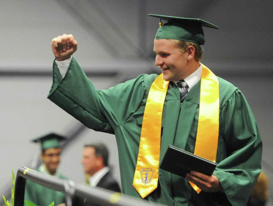 Bryan Ross fist pumps after receiving his diploma at the New Milford High School 2014 Graduation Ceremony at Western Connecticut State University's O'Neill Center in Danbury, Conn. Saturday, June 21, 2014. Photo: Tyler Sizemore / The News-Times