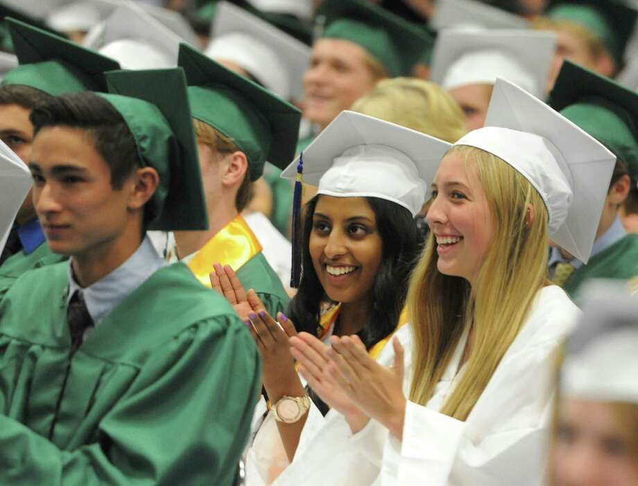 Diana Daniel, left, and Megan Daily clap during the New Milford High School 2014 Graduation Ceremony at Western Connecticut State University's O'Neill Center in Danbury, Conn. Saturday, June 21, 2014. Photo: Tyler Sizemore / The News-Times