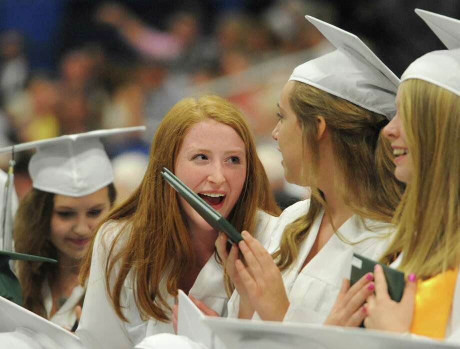 Sara Terry chats with fellow grads during the the New Milford High School 2014 Graduation Ceremony at Western Connecticut State University's O'Neill Center in Danbury, Conn. Saturday, June 21, 2014. Photo: Tyler Sizemore / The News-Times